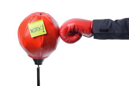 businessman fist punch red punching bag , business concept