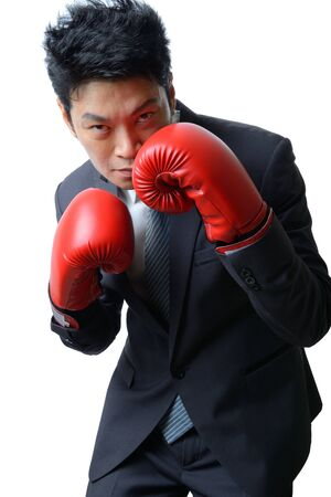 businessman with red boxing glove ready to fight with work, business concept Standard-Bild
