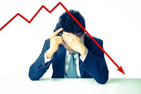 The depressed businessman holding a gun behind bad Stock market chart
