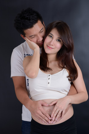 Beautiful young asian couple expecting baby