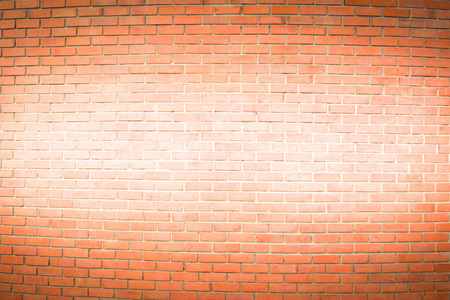 brown brick wall is painted white in the middle for texture background