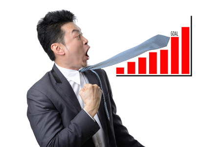 businessman looking shocked in financial graph be over goal isolated on white background