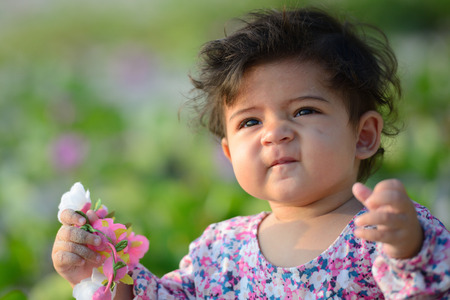 Closeup of cute adorable mixed race baby with innocent expression
