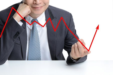 stockholder: businessman use finger to change from downing to be rising arrow, representing business growth. Stock Photo