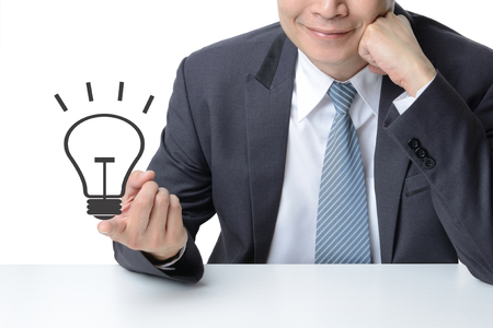 businessman finger with a drawing light bulb isolated on white background,Idea concept