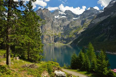 View of Oeschinensee (Oeschinen) Lake whrer is UNESCO World Heritage Siteat at Kandersteg, Switzerland in summer