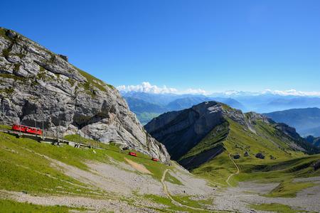ALPNACHSTAD, SWITZERLAND - AUGUST 26, 2016: The world's steepest cogwheel railway leading to a peak of Mount Pilatus. Editorial