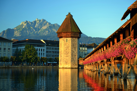 Historic city center of Lucerne with famous Chapel Bridge, the city's symbol and one of the Switzerland's main tourist attractions on a morning sunrise in summer and backdrop is Pilatus mountain, Canton of Lucerne, Switzerland