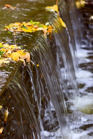 waterfall in the city: A waterfall fountain in a city park Stock Photo