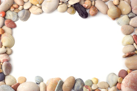 Frame made of sea pebbles and shells on white background photo