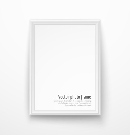 Blank white picture frame design on white wall. Vectores