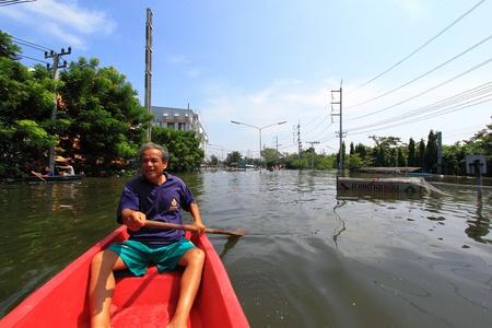 thailand flood: PRATHUMTHANI, THAILAND - OCT 23 : flooded street after flood disaster in Nava nakorn, Patumtana, Thailand on October 23, 2011.