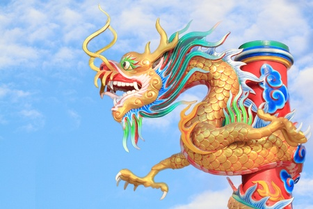 Chinese golden dragon with blue sky  photo