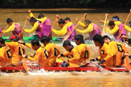 SARABURI,THAILAND - SEPTEMBER 22  Unidentified crew in traditional Thai long boats compete during Queen Cup Traditional Long Boat Race Championship on September 22, 2012 in Saraburi,Thailand