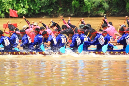 paddler: SARABURI,THAILAND - SEPTEMBER 22  Unidentified crew in traditional Thai long boats compete during Queen Cup Traditional Long Boat Race Championship on September 22, 2012 in Saraburi,Thailand