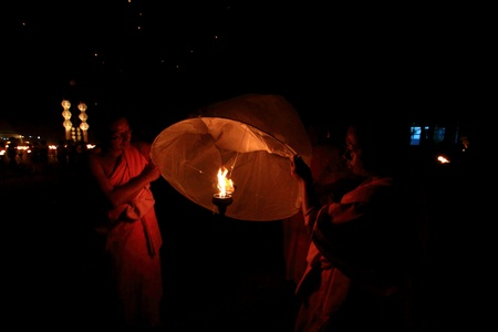 newyears: CHIANGMAI, THAILAND - NOVEMBER 24:Thai people floating lamp. November 24 ,2012 in Tudongkasatarn, Chiangmai, Thailand. Tudongkasatarn is where floating lamp ceremony takes place every year