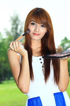 Woman makeup with brush and colors