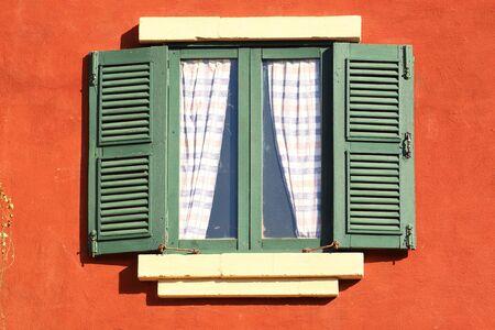 Window on the orange wall Stock Photo