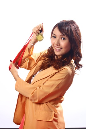 Woman holding a medal