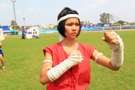 pugilist: AYUTTHAYA - MARCH 17: The 9th World Thai Martial Arts Festival and Wai Khru Muay Thai Ceremony at Wat Mahathat Phra Nakhon Si Ayutthaya Historical Park on March 17, 2013 in Phra Nakhon Si Ayutthaya, Thailand. Editorial