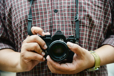 old photograph: Retro camera in photographer hand vintage tone concept background Stock Photo