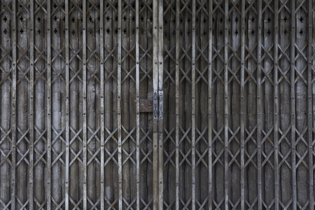 metal grid: Vintage Shutter door, old rusted iron sliding gates, background and texture