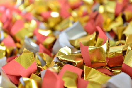 joss paper gold and silver paper for worship with Joss Paper Chinese Tradition. Gold Paper folded for passed away ancestors spirits for chinese ceremony.