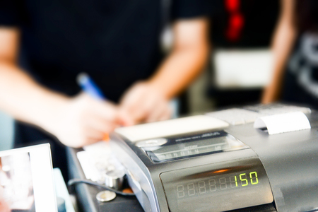 Blur cashier counter in the supermarket,Cashier at a supermarket checkout in a department store
