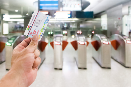 25-February 2018 Passenger holding ticket at the entrance at Singapore MRT station