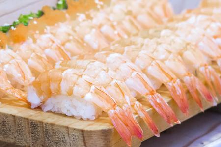 Shrimp sushi soft focus background. traditional sushi on the wooden dish