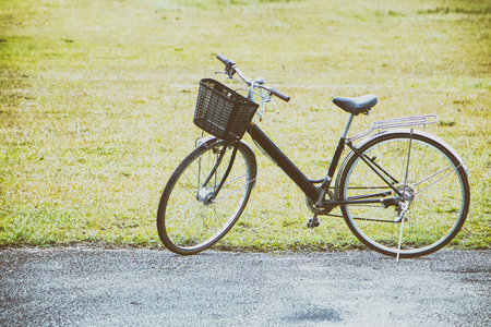 Vintage Bicycle in grassfield.motivation and inspiration concept.Film grain effect