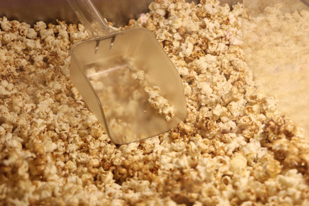 Popcorn texture.Salted popcorn in plastic box ready for sell