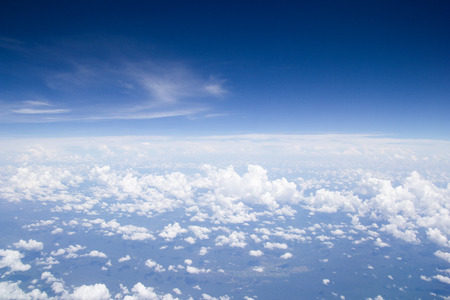 Blue sky cloud background.aerial view abstract beautiful sky over the ocean from airplane window Reklamní fotografie