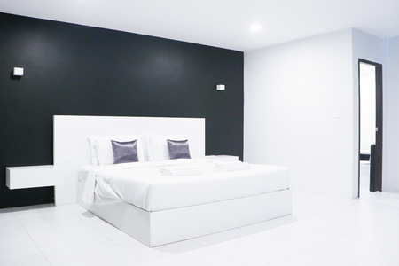 Bedroom interior. Comfortable modern white and black bedroom