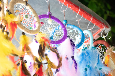 Dream catcher on the bright background.Dream catcher is native american cultures handmade willow hoop, on which is woven a net or web may also include sacred items such as certain feathers or beads