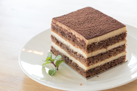 Chocolate cake on wooden desk.Chocolate is a usually sweet, brown food preparation of roasted and ground cacao seeds