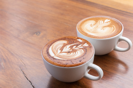 Coffee cup of cappuccino with latte art in coffee shop.Coffee is one of the most popular beverages.Improve Energy Levels and Burn Fat