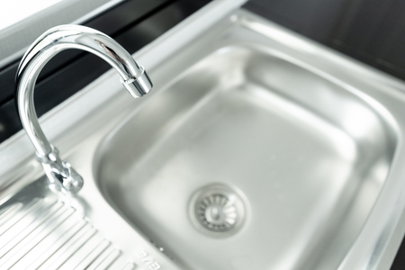 Kitchen sink is a bowl-shaped fixture used for washing hands or small objects