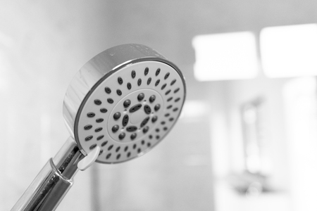 A shower is a place in which a person bathes under a spray of typically warm or hot water Reklamní fotografie - 117428458