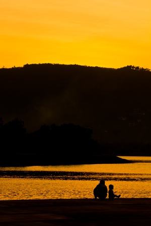Silhouette of family after sunset photo