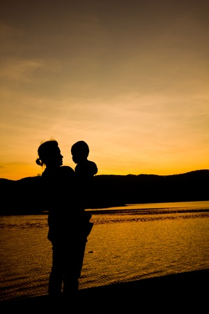 Silhouette of family after sunset