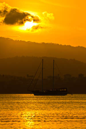 sailboat in sunset at koh samui photo