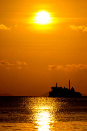 Ferry boat on sunset photo
