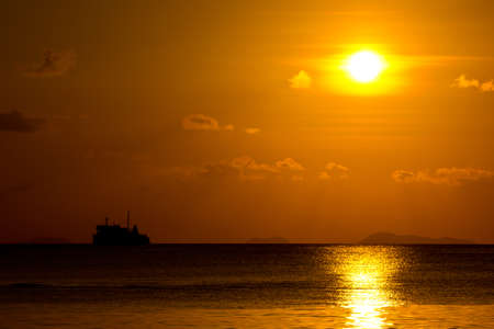 Ferry boat on sunset photo