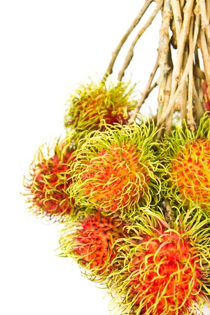 A Bunch Of Ripe Rambutan on white background Stock Photo