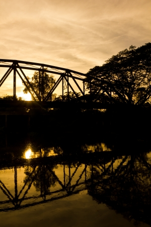 silhouette railway bridge after sunset photo