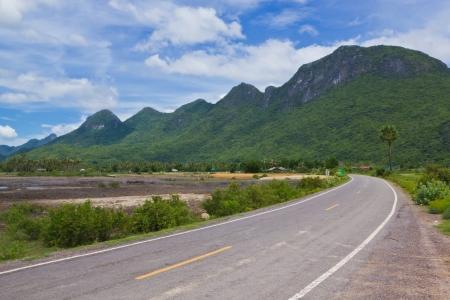 The road winding along mountain photo