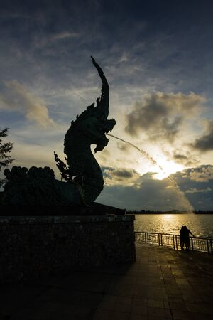 The head great parent NAK statue spray water at Songkhla Thailand photo