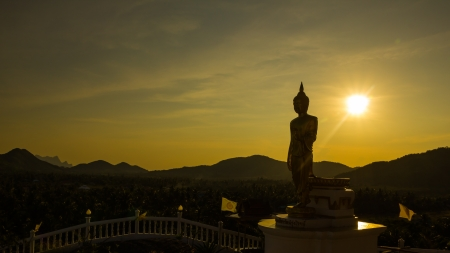 Golden Buddha statue in a Buddhist temple photo