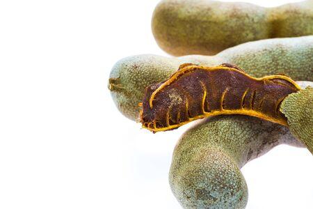 Ripe tamarind fruit on white background photo